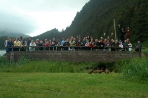 A big group from Gustavus poses on the Hobbit Hole bridge, one of many gatherings at this special property.